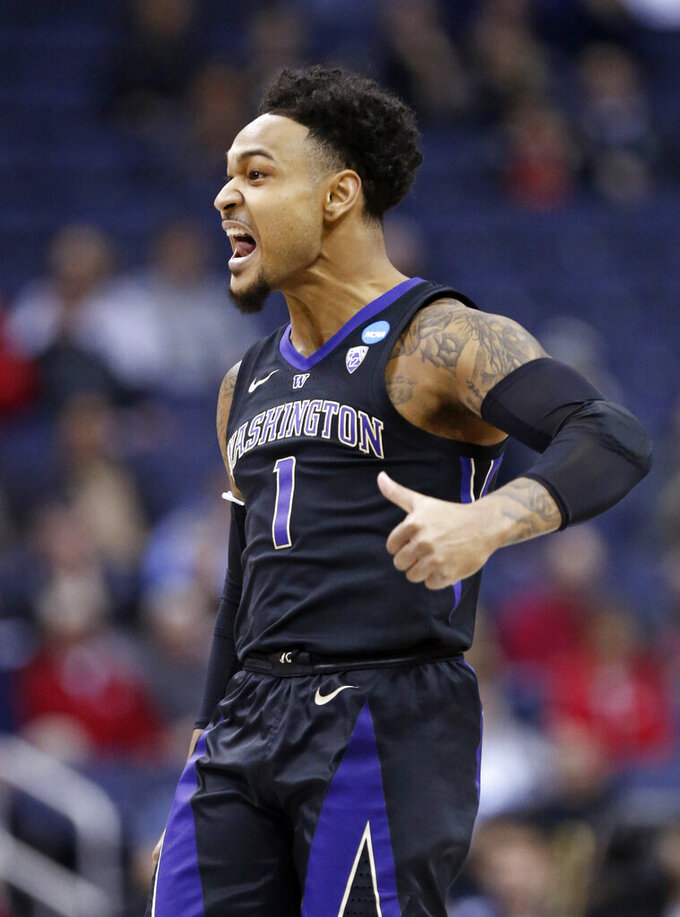 Washington's David Crisp reacts in the first half against Utah State during a first round men's college basketball game in the NCAA Tournament in Columbus, Ohio, Friday, March 22, 2019. (AP Photo/Paul Vernon)