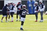 New England Patriots defensive back Terrence Brooks (25) carries the ball during an NFL football training camp practice, Friday, Aug. 21, 2020, in Foxborough, Mass. (AP Photo/Michael Dwyer, Pool)