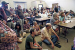 In this Aug. 15, 2019 photo, a crowd of over 100 community members packs the Pecos Municipal Building in Pecos, N.M., to listen to presentations and to stand in opposition of proposals to mine a piece of the Santa Fe National Forest. (Gabriela Campos/Santa Fe New Mexican via AP)