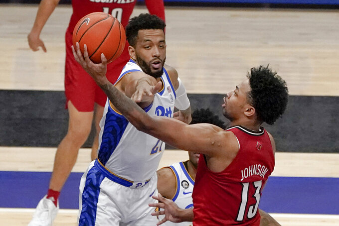 Louisville's David Johnson (13) shoots as Pittsburgh's Terrell Brown (21) defends during the second half of an NCAA college basketball game, Tuesday, Dec. 22, 2020, in Pittsburgh. (AP Photo/Keith Srakocic)