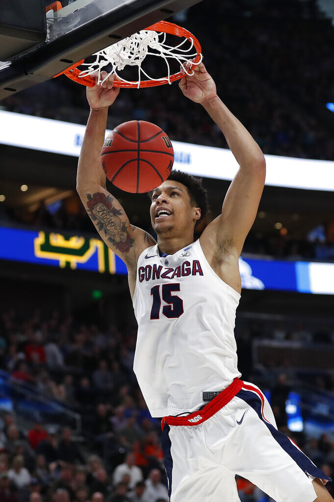 Gonzaga forward Brandon Clarke dunks during the first half of the team's second-round game against Baylor in the NCAA men's college basketball tournament Saturday, March 23, 2019, in Salt Lake City. (AP Photo/Jeff Swinger)