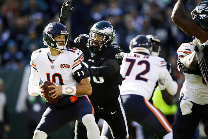 Chicago Bears' Mitchell Trubisky (10) is tackled by Philadelphia Eagles' Derek Barnett (96) during the first half of an NFL football game, Sunday, Nov. 3, 2019, in Philadelphia. (AP Photo/Matt Rourke)