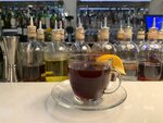 In this Wednesday, Dec. 4, 2019 photo a warm winter bishop cocktail is displayed at the Swift cocktail bar in London,  While mulled wine, warm spiced cider and hot toddies have long been British staples during winter many cocktail bars in London offer their own seasonal winter warmers.  (AP Photo/Louise Dixon)