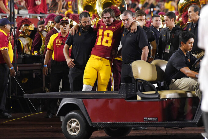 Southern California quarterback JT Daniels is helped to a cart after being injured during the first half of an NCAA college football game against Fresno State Saturday, Aug. 31, 2019, in Los Angeles. (AP Photo/Mark J. Terrill)