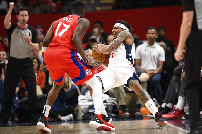 Washington Wizards guard Bradley Beal (3) is fouled by Detroit Pistons guard Tony Snell (17) during the first half of an NBA basketball game, Monday, Jan. 20, 2020, in Washington. (AP Photo/Nick Wass)