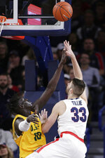 Gonzaga forward Killian Tillie (33) shoots over San Francisco forward Josh Kunen (10) during the first half of an NCAA college basketball game in Spokane, Wash., Thursday, Feb. 20, 2020. (AP Photo/Young Kwak)
