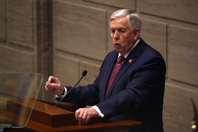 Missouri Gov. Mike Parson delivers the State of the State address Wednesday, Jan. 27, 2021, in Jefferson City, Mo. The speech is traditionally given in the House chamber but was moved to the smaller Senate chamber at the last minute due to concerns about the coronavirus. (AP Photo/Jeff Roberson)