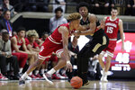 Indiana guard Romeo Langford (0) gets tied up with Purdue guard Nojel Eastern (20) during the second half of an NCAA college basketball game in West Lafayette, Ind., Saturday, Jan. 19, 2019. Purdue defeated Indiana 70-55. (AP Photo/Michael Conroy)