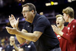 Stanford head coach Jerod Haase cheers on his team during the first half of an NCAA college basketball game against Oklahoma, Monday, Nov. 25, 2019, in Kansas City, Mo. (AP Photo/Charlie Riedel)