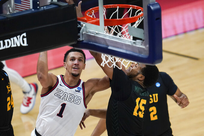 Gonzaga guard Jalen Suggs (1) drives on Norfolk State forward J.J. Matthews (15) during the second half of a men's college basketball game in the first round of the NCAA tournament at Bankers Life Fieldhouse in Indianapolis, Saturday, March 20, 2021. (AP Photo/Paul Sancya)