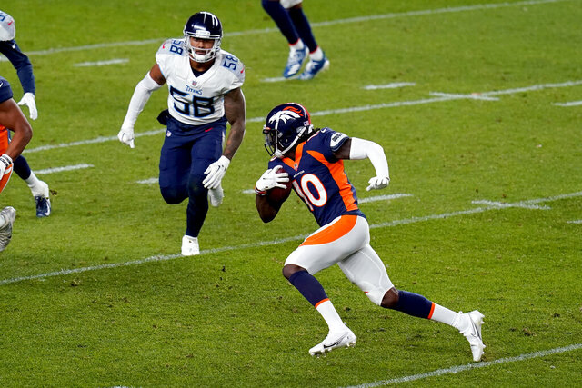 Denver Broncos wide receiver Jerry Jeudy (10) runs the ball as Tennessee Titans linebacker Harold Landry (58) pursues during the first half of an NFL football game, Monday, Sept. 14, 2020, in Denver. (AP Photo/Jack Dempsey)