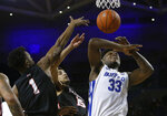 Buffalo forward Nick Perkins (33) is fouled by Ball State forward Zach Gunn (15) during the first half of an NCAA college basketball game Tuesday, Jan. 29, 2019, in Buffalo N.Y. (AP Photo/Jeffrey T. Barnes)