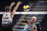 FILE - In this Aug. 2, 2021, file photo, Jacob Gibb, right, of the United States, shoots against Germany's Julius Thole, left, during a men's beach volleyball match at the 2020 Summer Olympics in Tokyo, Japan. The Chicago stop of the AVP beach volleyball tour is turning into a farewell for four-time Olympian Gibb. Gibb says that the Chicago Open on Lake Michigan's Oak Street Beach this weekend will be the last domestic stop for him. (AP Photo/Felipe Dana, File)