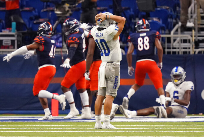 Middle Tennessee quarterback Asher O'Hara (10) reacts after throwing an incomplete pass on a 2-point conversion attempt against UTSA during the second half of an NCAA college football game Friday, Sept. 25, 2020, in San Antonio. UTSA won 37-35. (AP Photo/Eric Gay)