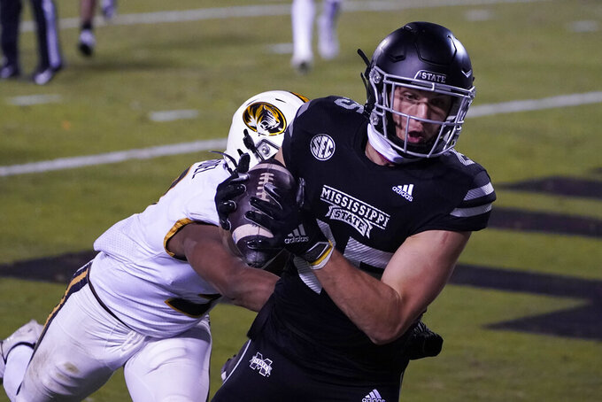 Mississippi State wide receiver Brad Cumbest (25) pulls in a 10-yard touchdown pass reception in front of Missouri safety Martez Manuel (3) during the second half of an NCAA college football game, Saturday, Dec. 19, 2019, in Starkville, Miss. (AP Photo/Rogelio V. Solis)