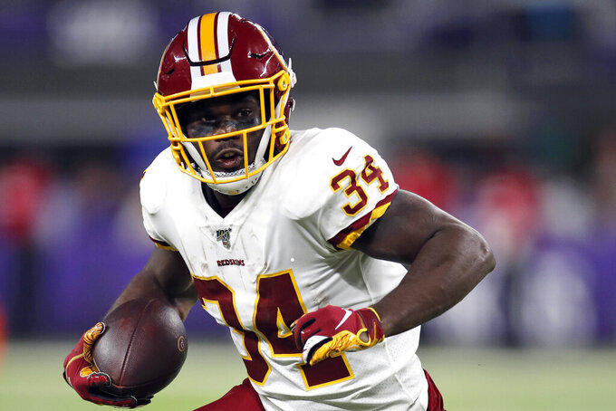 FILE - In this Oct. 24, 2019, file photo, Washington Redskins running back Wendell Smallwood (34) runs the ball against the Minnesota Vikings during an NFL football game in Minneapolis. The Pittsburgh Steelers have signed Smallwood to a one-year deal, giving the backfield a bit of experienced depth heading into training camp. (Jeff Haynes/AP Images for Panini, File)