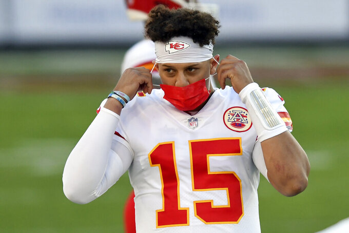 Kansas City Chiefs quarterback Patrick Mahomes (15) wears a protective face mask during the first half of an NFL football game against the Tampa Bay Buccaneers Sunday, Nov. 29, 2020, in Tampa, Fla. (AP Photo/Jason Behnken)