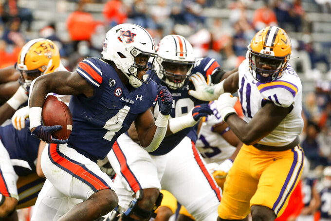 Auburn running back Tank Bigsby (4) carries the ball during the second quarter of an NCAA college football game against LSU, Saturday, Oct. 31, 2020, in Auburn, Ala. (AP Photo/Butch Dill)