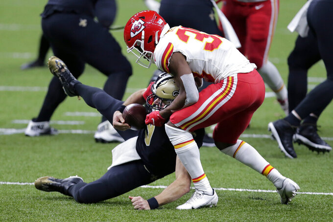 Kansas City Chiefs cornerback L'Jarius Sneed brings down New Orleans Saints quarterback Drew Brees in the first half of an NFL football game in New Orleans, Sunday, Dec. 20, 2020. (AP Photo/Brett Duke)
