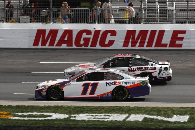 Drivers Denny Hamlin (11) and Cole Custer, rear, race side-by-side during a NASCAR Cup Series auto race, Sunday, Aug. 2, 2020, at the New Hampshire Motor Speedway in Loudon, N.H. (AP Photo/Charles Krupa)