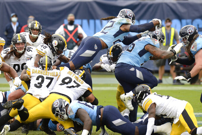 Tennessee Titans running back Derrick Henry (22) dives over the goal line for a touchdown against the Pittsburgh Steelers in the second half of an NFL football game Sunday, Oct. 25, 2020, in Nashville, Tenn. (AP Photo/Mark Zaleski)