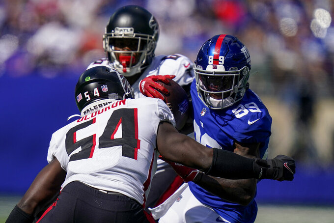 New York Giants wide receiver Kadarius Toney (89) runs the ball against Atlanta Falcons linebacker Foye Oluokun (54) during the first half of an NFL football game, Sunday, Sept. 26, 2021, in East Rutherford, N.J. (AP Photo/Seth Wenig)