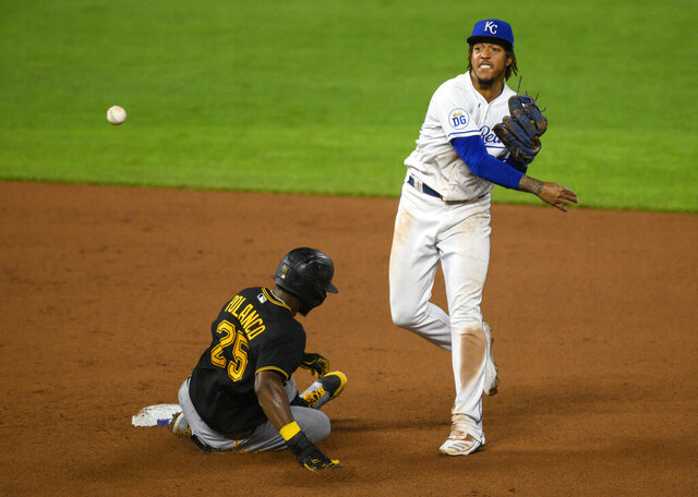 Kansas City Royals shortstop Adalberto Mondesi, right, forces out Pittsburgh Pirates' Gregory Polanco, left, and throws to first for a double play during the seventh inning of a baseball game in Kansas City, Mo., Saturday, Sept. 12, 2020. (AP Photo/Reed Hoffmann)