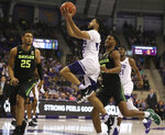 TCU guard Alex Robinson, center, drives past Baylor guard Jared Butler, right, and forward Tristan Clark, left, in the first half of an NCAA college basketball game, Saturday, Jan. 5, 2019, in Fort Worth, Texas. (Rod Aydelotte/Waco Tribune Herald via AP)