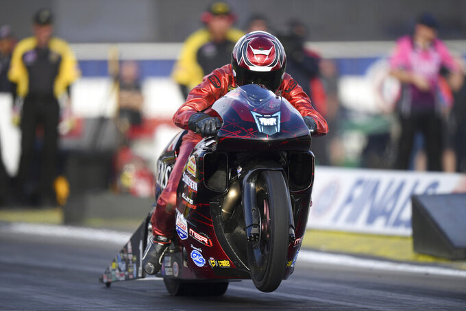 In this photo provided by the NHRA, Matt Smith drives in Pro Stock Motorcycle qualifying for the Auto Club NHRA Finals on Friday, Nov. 15, 2019, at Auto Club Raceway in Pomona, Calif. (Marc Gewertz/NHRA via AP)