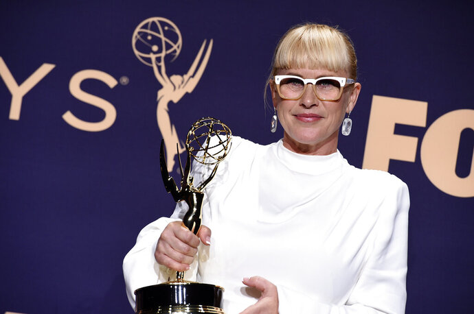 Patricia Arquette poses in the press room with the award for outstanding supporting actress in a limited series or movie for