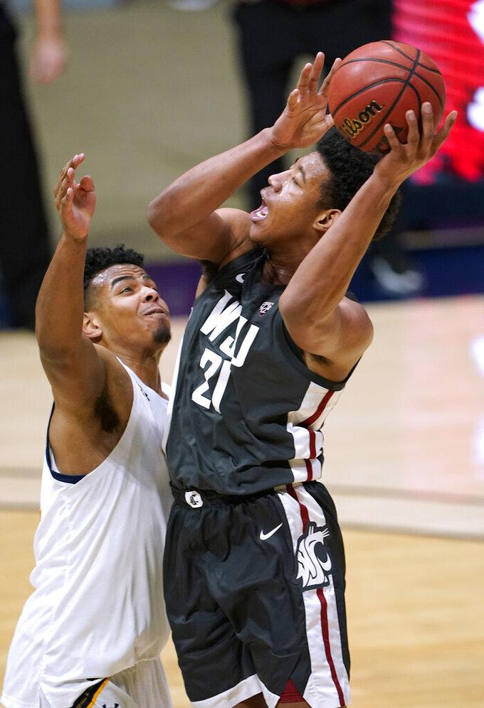 Washington State center Dishon Jackson (21) shoots over California forward Andre Kelly, left, during the second half of an NCAA college basketball game, Thursday, Jan. 7, 2021, in Berkeley, Calif. (AP Photo/Tony Avelar)