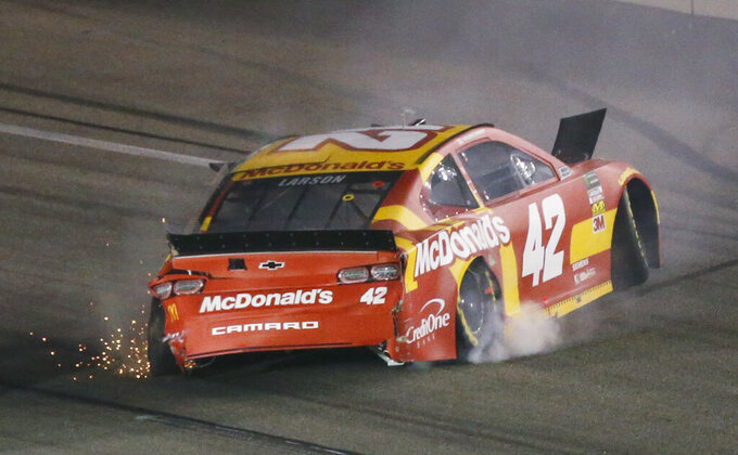 Kyle Larson backs his car down the track after he spun during the NASCAR Cup series auto race at Richmond Raceway in Richmond, Va., Saturday, April 13, 2019. (AP Photo/Steve Helber)