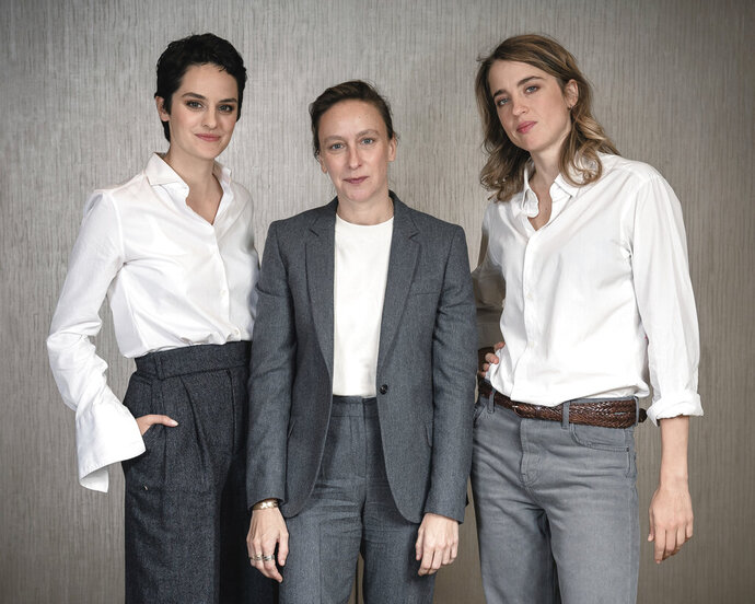 This Sept. 30, 2019 photo shows, from left, actress Noémie Merlant, filmmaker Céline Sciamma, and actress Adèle Haenel posing for a portrait in New York to promote their film,