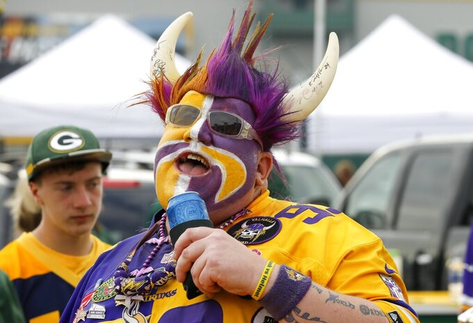 A fan tailgates before an NFL football game between the Green Bay Packers and the Minnesota Vikings Sunday, Sept. 15, 2019, in Green Bay, Wis. (AP Photo/Mike Roemer)