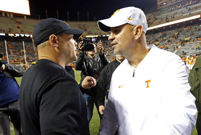 Tennessee head coach Jeremy Pruitt, right, congratulates Missouri head coach Barry Odom after an NCAA college football game Saturday, Nov. 17, 2018, in Knoxville, Tenn. Missouri won 50-17. (AP Photo/Wade Payne)