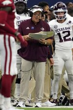 Texas A&M head coach Jimbo Fisher watches play against Arkansas in the first half of an NCAA college football game in Arlington, Texas, Saturday, Sept. 25, 2021. (AP Photo/Tony Gutierrez)