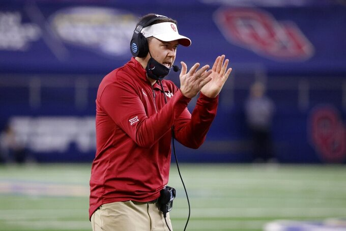 Oklahoma coach Lincoln Riley cheers on his team during the second half of the Cotton Bowl NCAA college football game against Florida in Arlington, Texas, Wednesday, Dec. 30, 2020. (AP Photo/Michael Ainsworth)
