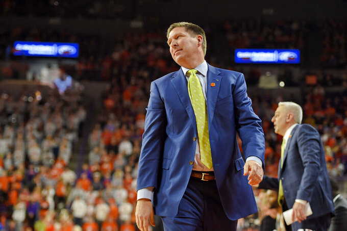 Clemson head coach Brad Brownell reacts to a play during the first half of an NCAA college basketball game against Florida State Saturday, Feb. 29, 2020, in Clemson, S.C. (AP Photo/Richard Shiro)