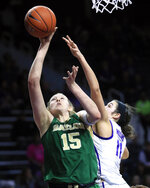 Baylor forward Lauren Cox (15) shoots while covered by Kansas State forward Peyton Williams (11) during the first half of an NCAA college basketball game in Manhattan, Kan., Wednesday, Feb. 13, 2019. (AP Photo/Orlin Wagner)