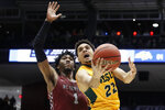 North Dakota State's Cameron Hunter (22) shoots against North Carolina Central's Zacarry Douglas (1) during the second half of a First Four game of the NCAA men's college basketball tournament Wednesday, March 20, 2019, in Dayton, Ohio. (AP Photo/John Minchillo)