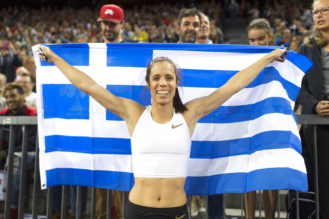 FLE - In this Aug. 30, 2018, file photo, Katerina Stefanidi from Greece celebrates after winning the women's pole vault event during the Weltklasse IAAF Diamond League international athletics meeting at Letzigrund stadium in Zurich, Switzerland. Three of the leading women's pole vaulters will take their turn to compete in the second edition of the Ultimate Garden Clash. Katerina Stefanidi of Greece, Katie Nageotte of the United States and Alysha Newman of Canada will participate in the event but won't be competing in their backyards since they don't have the equipment at home. They will instead be at nearby training facilities.  (Ennio Leanza/Keystone via AP, FIle)