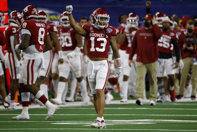 Oklahoma defensive back Tre Norwood (13) celebrates a third-down stop against Florida during the second half of the Cotton Bowl NCAA college football game in Arlington, Texas, Wednesday, Dec. 30, 2020. (AP Photo/Ron Jenkins)