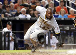 Pittsburgh Pirates' Starling Marte scores on a sacrifice fly by Corey Dickerson during the seventh inning of a baseball game against the Miami Marlins, Sunday, April 15, 2018, in Miami. (AP Photo/Lynne Sladky)