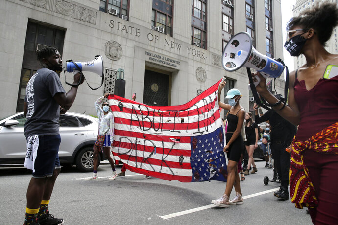 Protesters, many from the former encampment at City Hall Park, march for social justice in New York, Tuesday, July 28, 2020. (AP Photo/Seth Wenig)