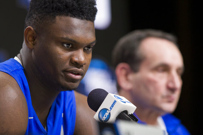 Duke forward Zion Williamson speaks, accompanied by head coach Mike Krzyzewski, during an NCAA men's college basketball news conference in Washington, Saturday, March 30, 2019. Duke plays Michigan State in the East Regional final game on Sunday. (AP Photo/Alex Brandon)