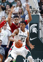 Michigan State's Xavier Tillman (23) maneuvers against Indiana's Juwan Morgan during the first half of an NCAA college basketball game, Saturday, Feb. 2, 2019, in East Lansing, Mich. (AP Photo/Al Goldis)