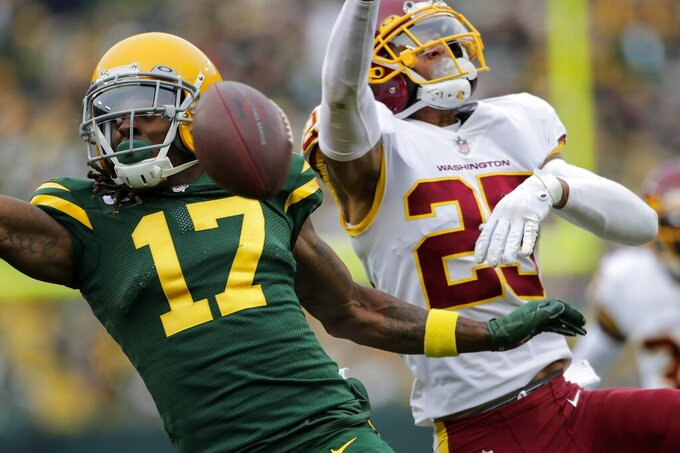 Washington Football Team's Benjamin St-Juste is called for pass interference on Green Bay Packers' Davante Adams during the second half of an NFL football game Sunday, Oct. 24, 2021, in Green Bay, Wis. (AP Photo/Aaron Gash)