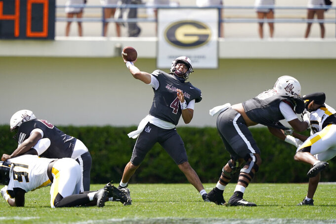 Alabama A&M quarterback Aqeel Glass (4) passes against Arkansas-Pine Bluff during the first half of the Southwestern Athletic Conference NCAA college football game, Saturday, May 1, 2021, in Jackson, Miss. (AP Photo/Rogelio V. Solis)