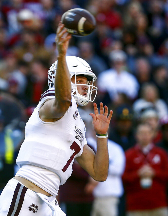 Mississippi State quarterback Nick Fitzgerald (7) throws a pass during the first half of an NCAA college football game against Alabama, Saturday, Nov. 10, 2018, in Tuscaloosa, Ala. (AP Photo/Butch Dill)