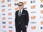 Actor Daniel Craig poses for photographs on the red carpet for the new movie